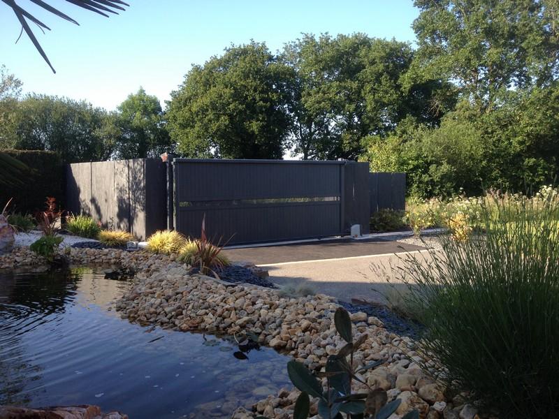 Portail coulissant Design. Jardins des 4 Saisons. Guer, Ploërmel, Redon, Plélan-Le-Grand, Maure de Bretagne